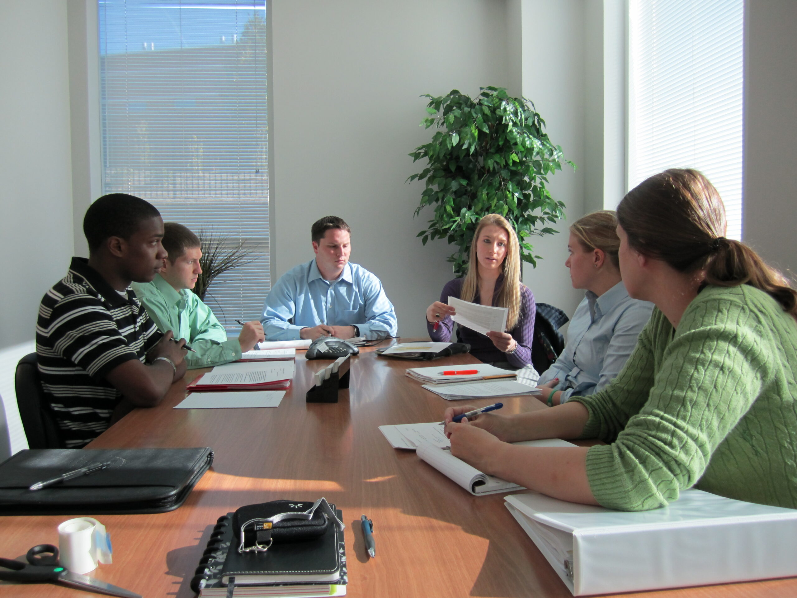A group of MMB faculty and staff in a conference room