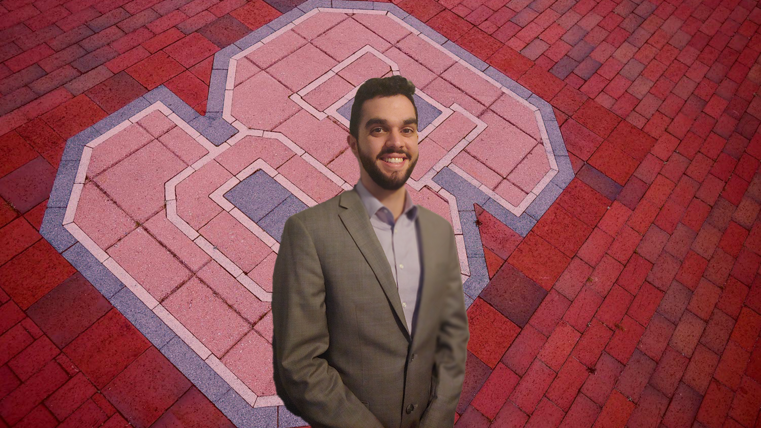 """Header for news post - MMB Student Dilan Rivera in front of The NC State block """"S"""" logo in brick off Varsity Drive."""